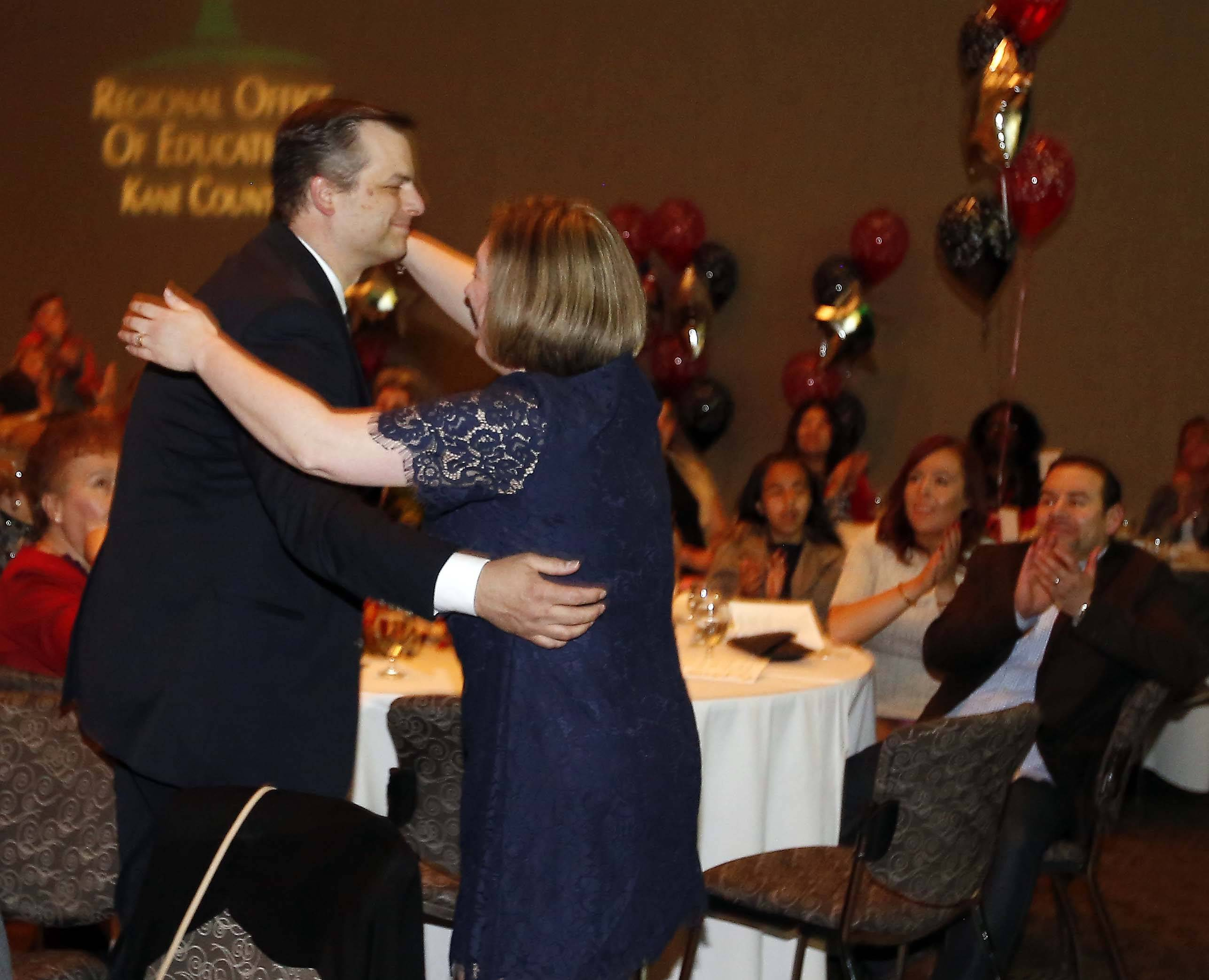 Kane County Educator of the Year Matt Gain gets a giant hug from his wife, Kerry. Gain, who teaches at Geneva Middle School South in District 304, took top honors Friday night at the Q Center in St. Charles.