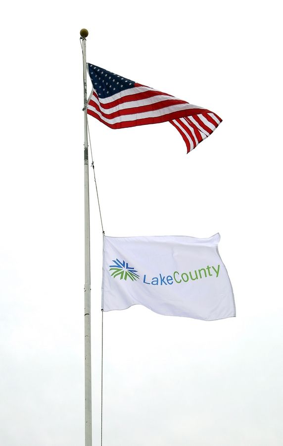 The Lake County flag flies at half-staff at the Lake County Division of Transportation facility in Libertyville to honor longtime Lake County Board member Audrey Nixon who died Thursday.