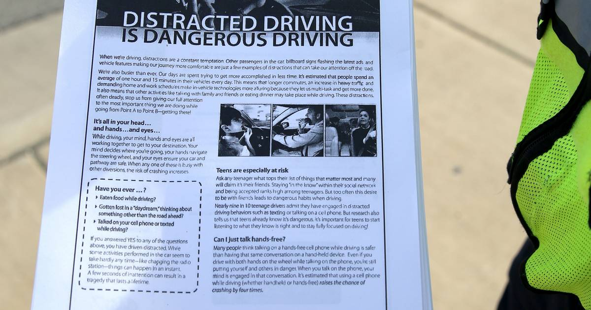 Texting While Driving >> Suburban police choose distracted driving flyers over tickets