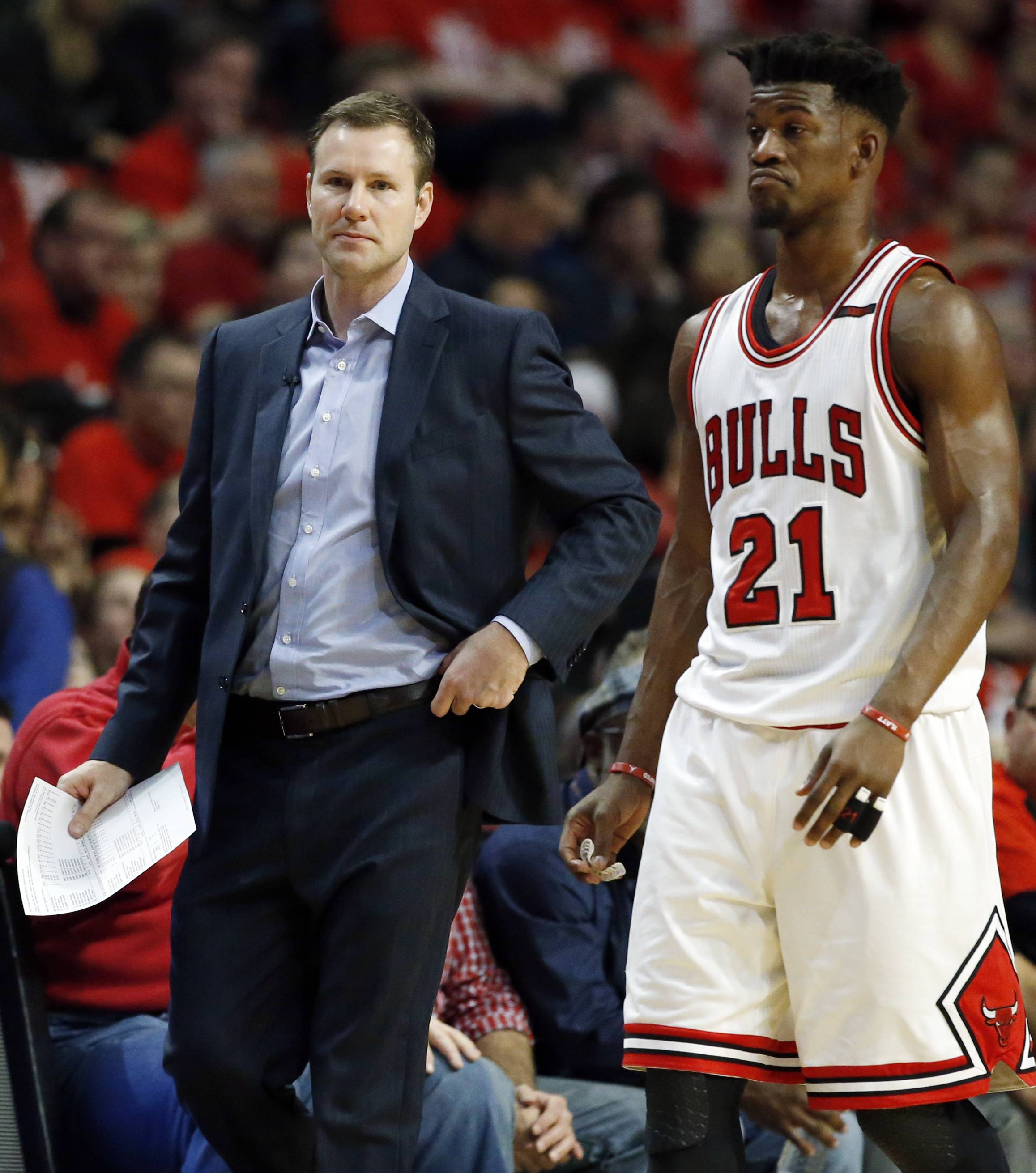 Bulls coach Fred Hoiberg, left, talks with Jimmy Butler during the first half in Game 6 against the Boston Celtics, Friday in Chicago. The Bulls quit Friday night in a fitting conclusion to a bizarre season.