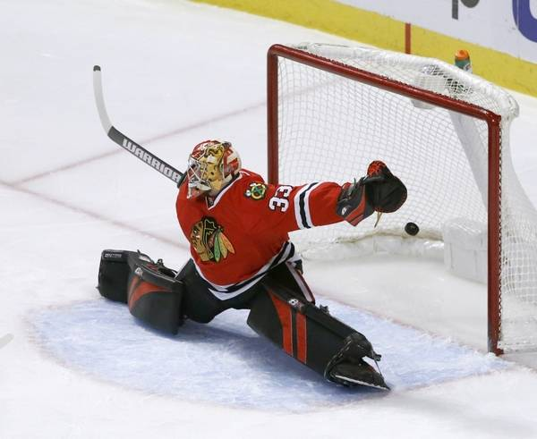 f3f3fc734 The Chicago Blackhawks have traded goalie Scott Darling to the Carolina  Hurricanes in exchange for a