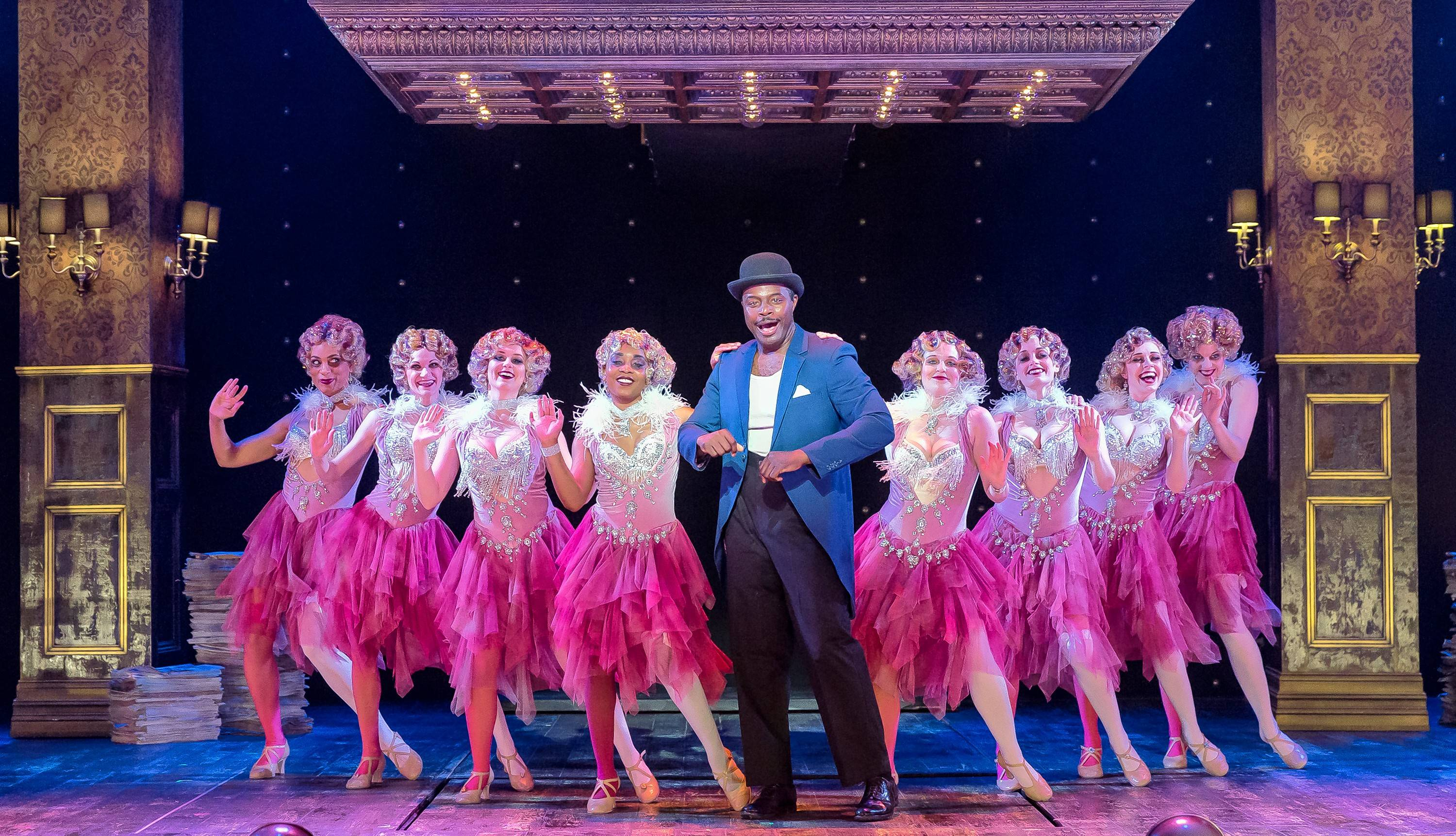 "High-priced attorney Billy Flynn (Guy Lockard) and a bevy of showgirls sing the number ""All I Care About"" in Drury Lane Theatre's homegrown production of the musical ""Chicago"" in Oakbrook Terrace."