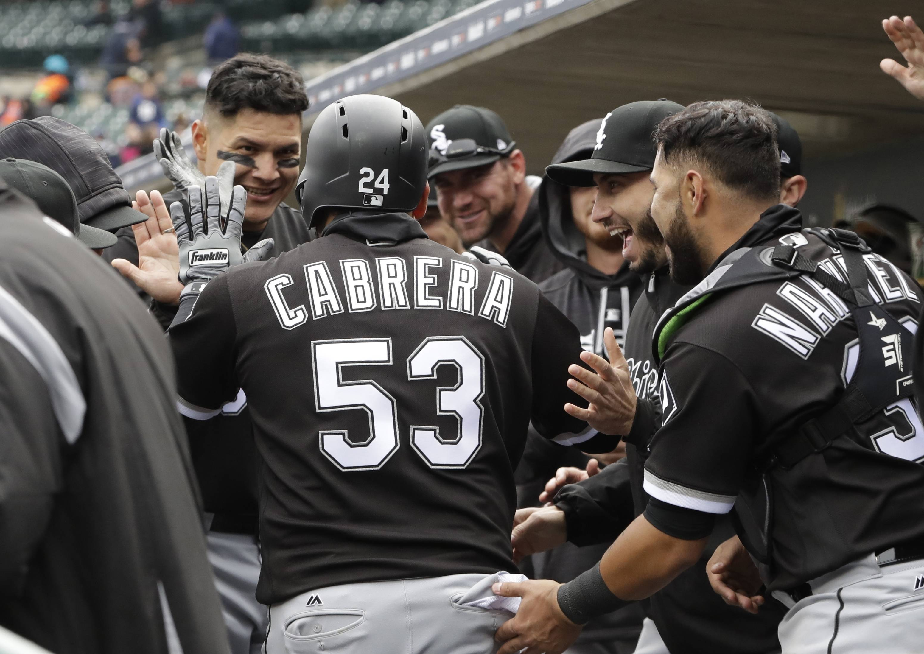 Chicago White Sox's Melky Cabrera is congratulated after his home run during the 10th inning of a baseball game against the Detroit Tigers, Saturday, April 29, 2017, in Detroit. (AP Photo/Carlos Osorio)