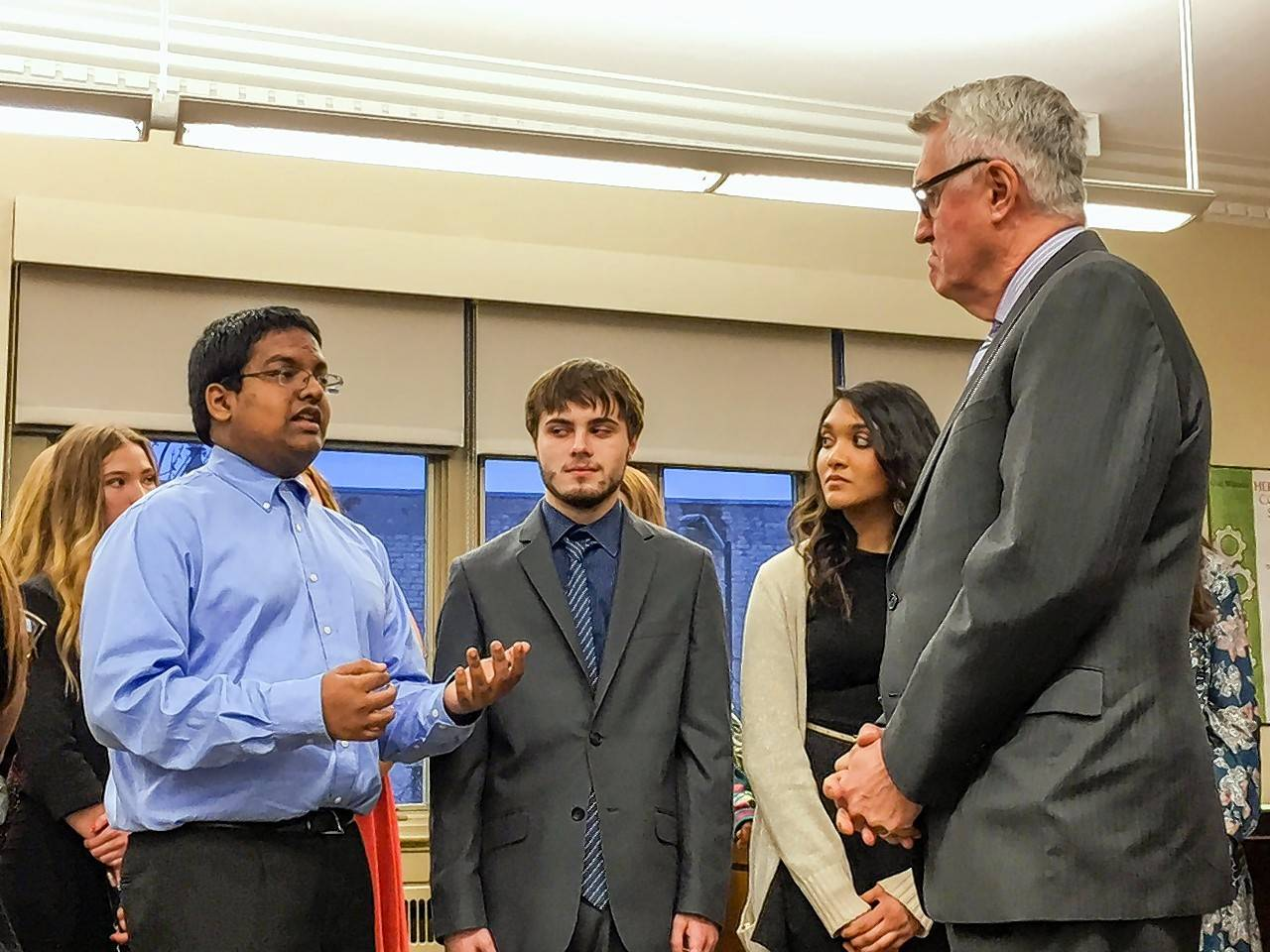 St. Charles North High School mock trial team member Sanjeev Viswan describes the road to the state title for Mayor Ray Rogina.