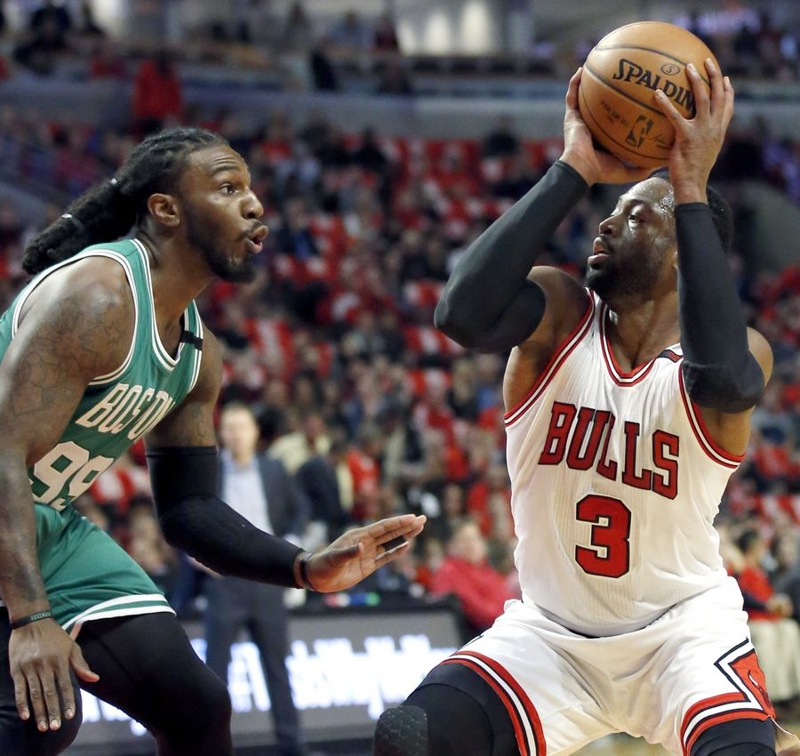 Chicago Bulls guard Dwyane Wade, right, looks for a shot against Boston Celtics forward Jae Crowder during the first half in Game 6 of an NBA basketball first-round playoff series, Friday, April. 28, 2017, in Chicago.