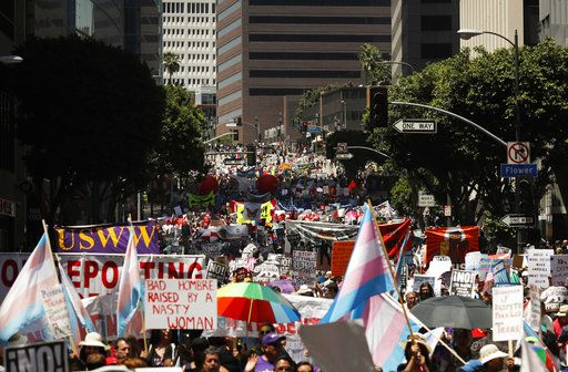 Thousands of protesters fill the street as they march during a May Day rally Monday, May 1, 2017, in Los Angeles. Thousands of people took to the streets across the nation Monday to march in May Day rallies, calling for immigration reform, workers' rights and police accountability.