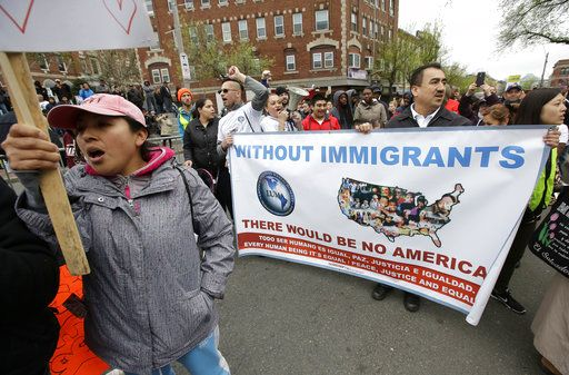 Demonstrators display placards and chant slogans during a May Day rally, Monday, May 1, 2017, in Chelsea, Mass. Thousands of people chanted, picketed and marched on cities across America on Monday as May Day demonstrations raged against President Donald Trump's immigration policies.