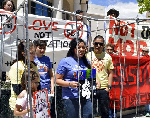 "Immigrant rights advocates speak out against immigration policies of President Donald Trump while placing themselves in ""mock detention"" in Albuquerque, N.M., to mark May Day on Monday, May 1, 2017. The demonstrations on May Day, celebrated as International Workers' Day, follow similar actions worldwide in which protesters from the Philippines to Paris demanded better working condition."