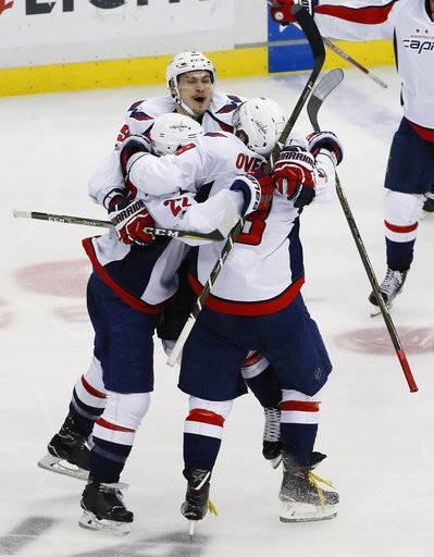 fa7eee2c3 Washington Capitals  Kevin Shattenkirk (22) celebrates with Dmitry Orlov  (9)