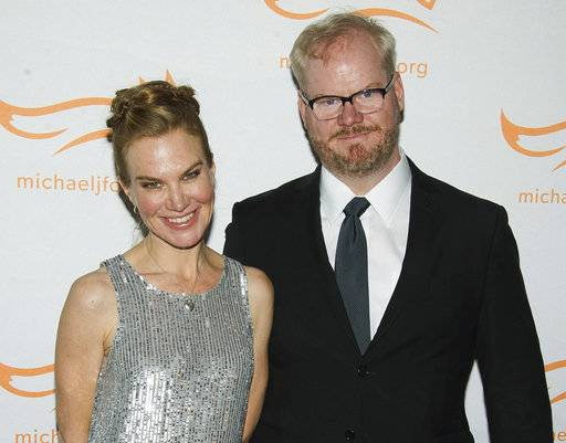 "FILE - In this Nov. 22, 2014 file photo, Jeannie Gaffigan, left, and Jim Gaffigan attend The Michael J. Fox Foundation for Parkinson's Research benefit, ""A Funny Thing Happened on the Way to Cure Parkinson's,"" in New York. Gaffigan says his wife and writing partner Jeannie is recovering after surgery to remove a serious brain tumor. He said on his social media pages Monday, May 1, 2017, that two weeks ago an MRI revealed that Jeannie Gaffigan had a large, life-threatening tumor around her brain stem. He says after nine hours of urgent surgery the tumor was completely removed, and she's now recovering at home. (Photo by Charles Sykes/Invision/AP, File)"