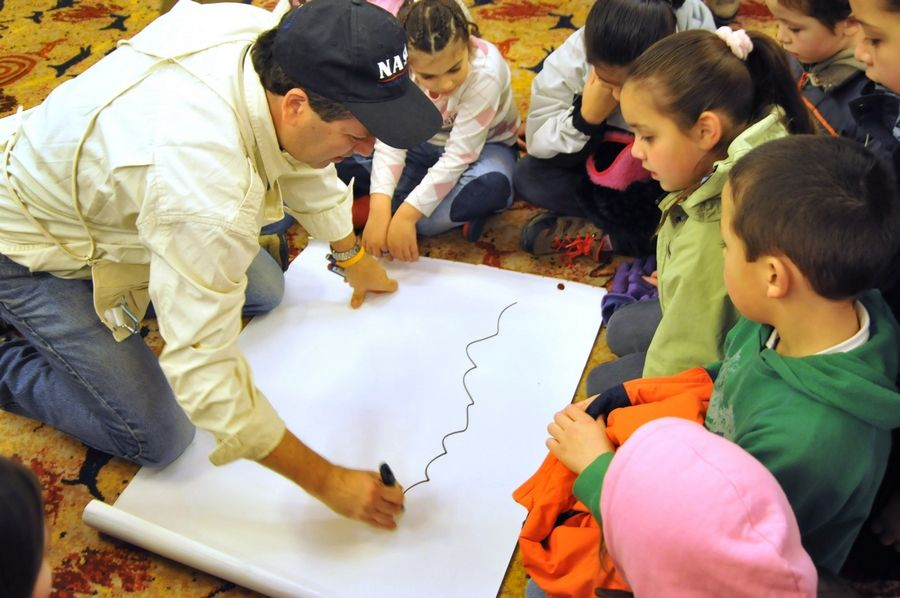 Teacher Charles Fulco works with students in Patagonia, Argentina, where a total eclipse occurred in February.
