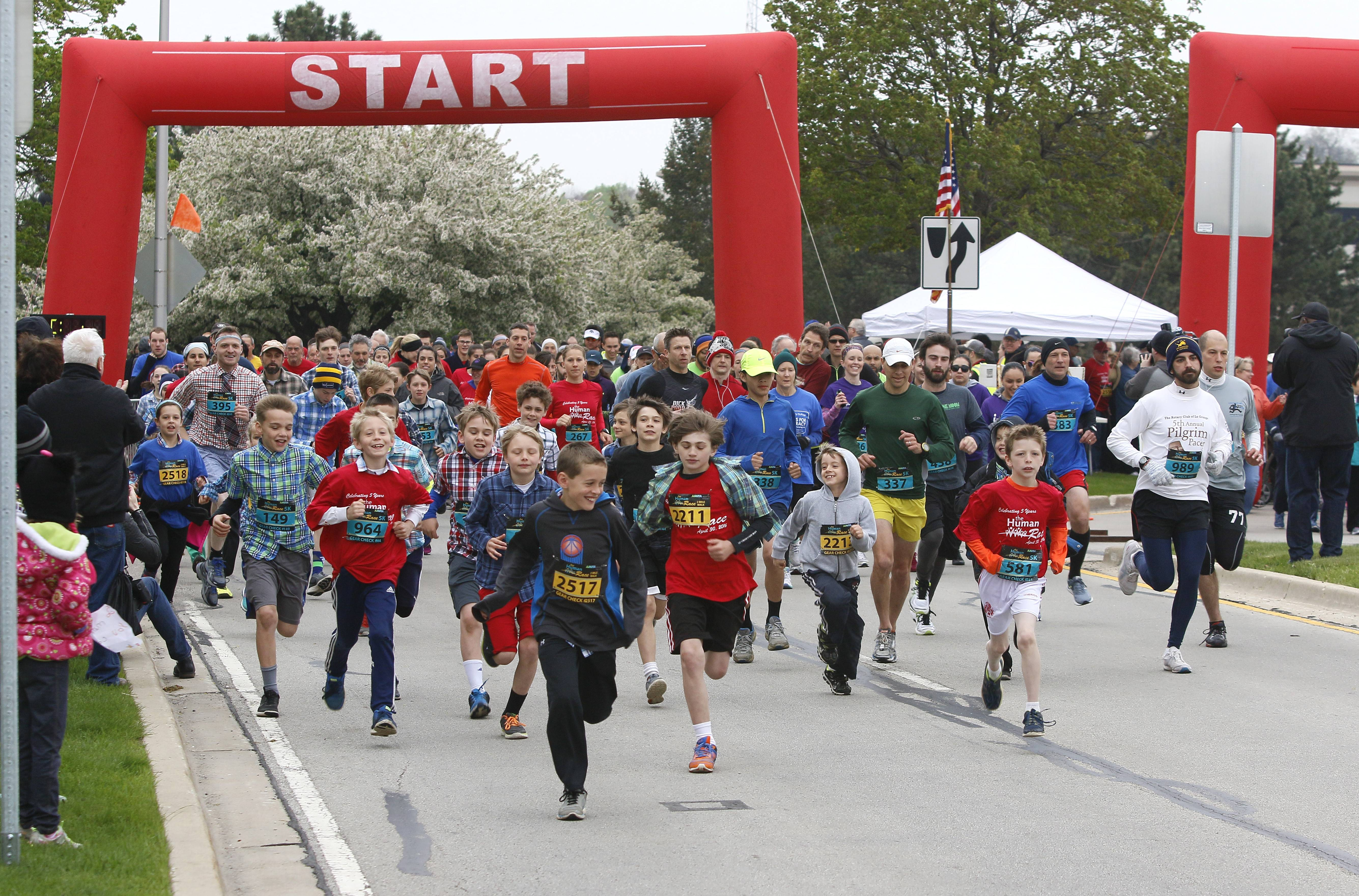 Kids sprint from the starting line at last year's DuPage Human Race in Downers Grove. The 5k race and 2-mile walk raises money for 72 local charities, and draws participants from toddlers to people in their 70s.