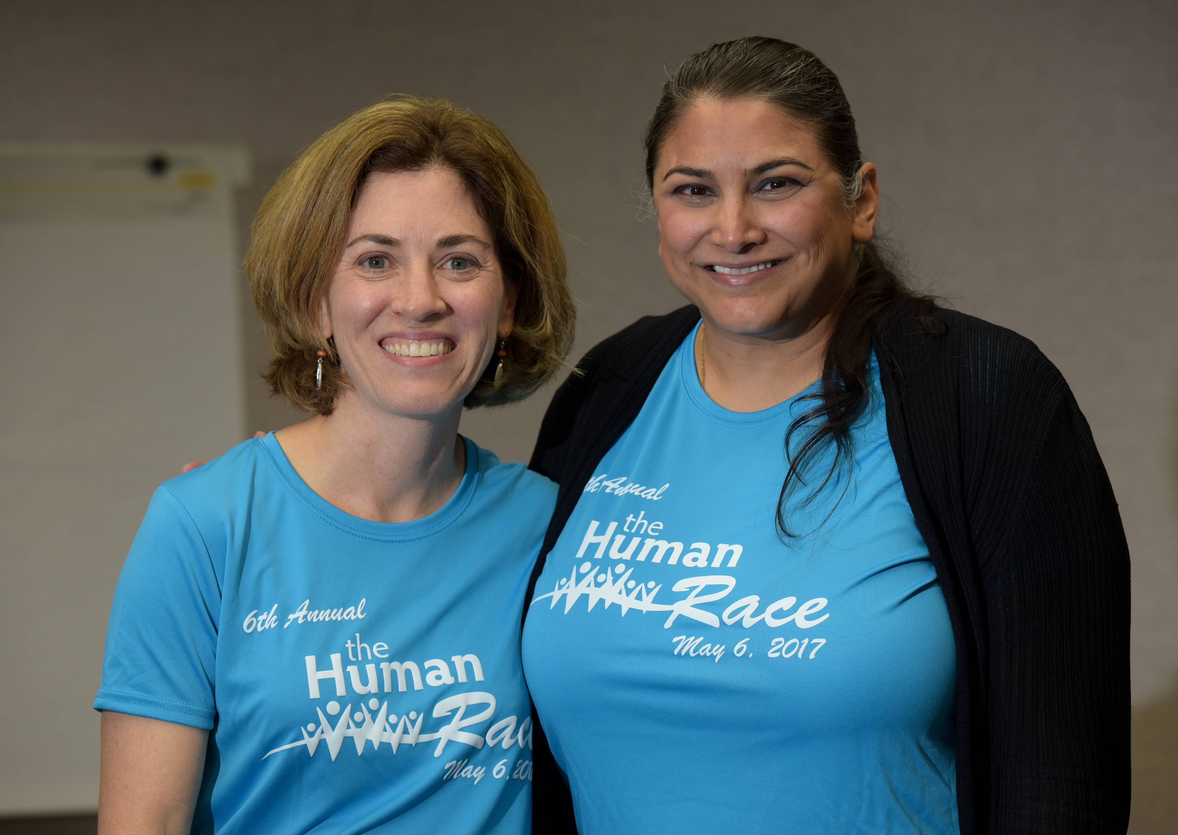 Working long hours to make sure Saturday's DuPage Human Race gives 72 local charities a chance to raise funds and awareness, race director Christine Kickels, left, and Shefali Trivedi, executive director of race sponsor Giving DuPage, never get the chance to run or walk in the event.