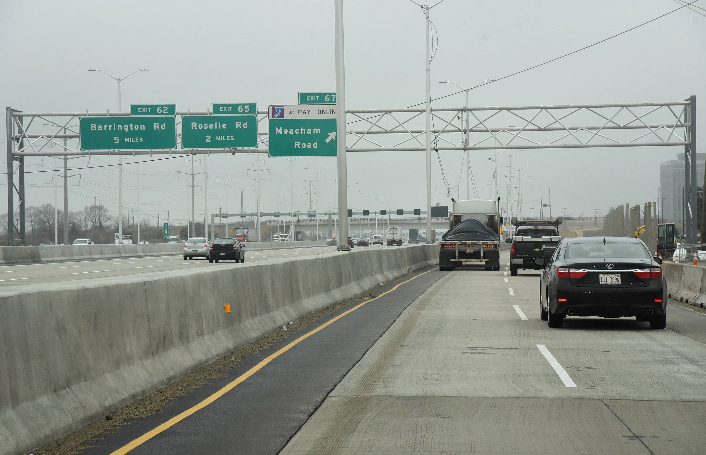 "A new emergency response agreement is helping local firefighters navigate a new concrete barrier, which they've dubbed the ""chute,"" dividing the local and express lanes of westbound I-90 from Route 53 to just past Meacham Road."