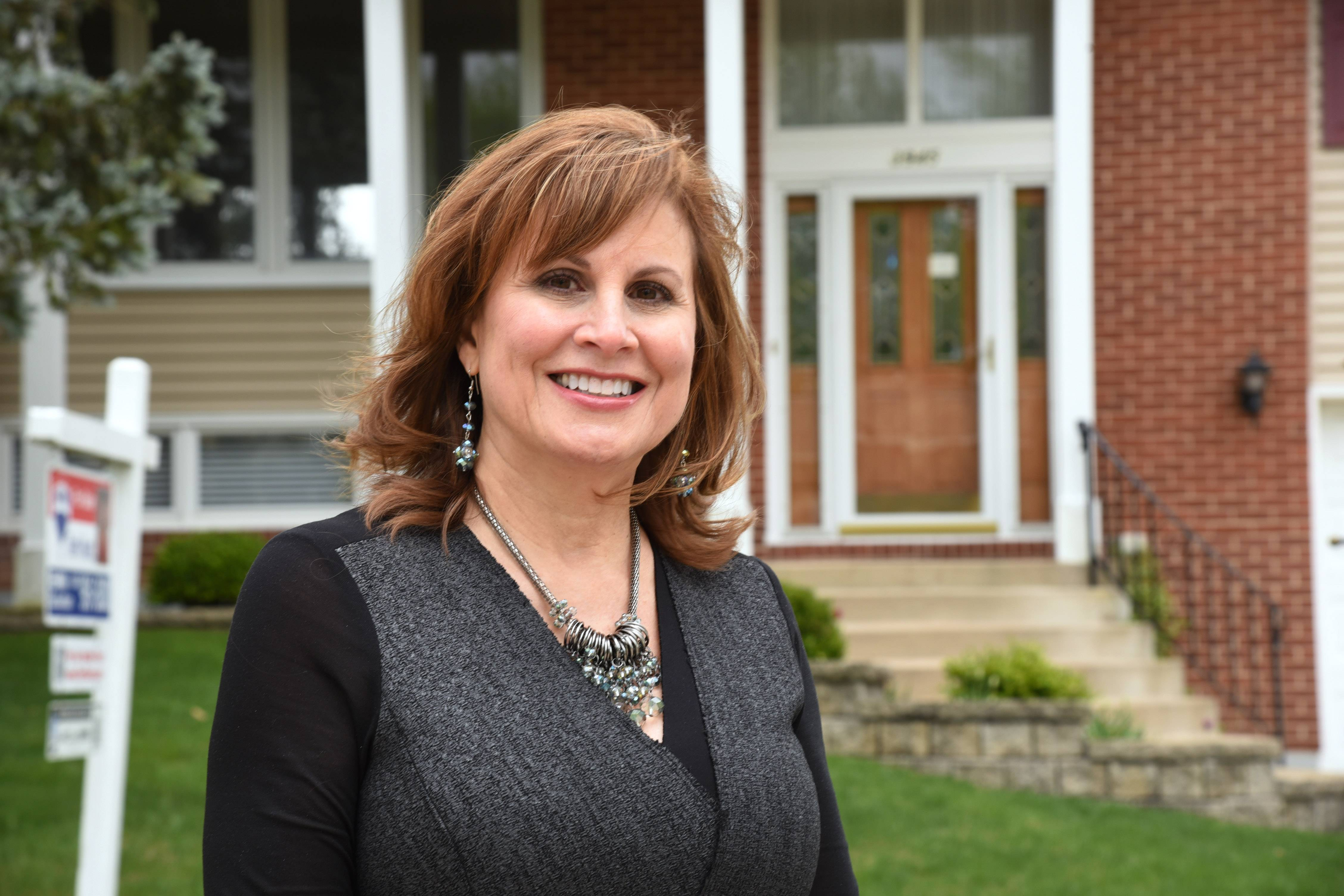 RE/MAX Suburban agent Terri Hunt in front of her listing in the Winston Knolls neighborhood of Hoffman Estates.