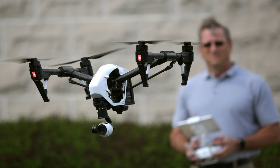Stan Taylor from Northwestern University Center for Public Safety flies a drone used in investigating crash scenes by the Lake County Major Crash Assistance Team.