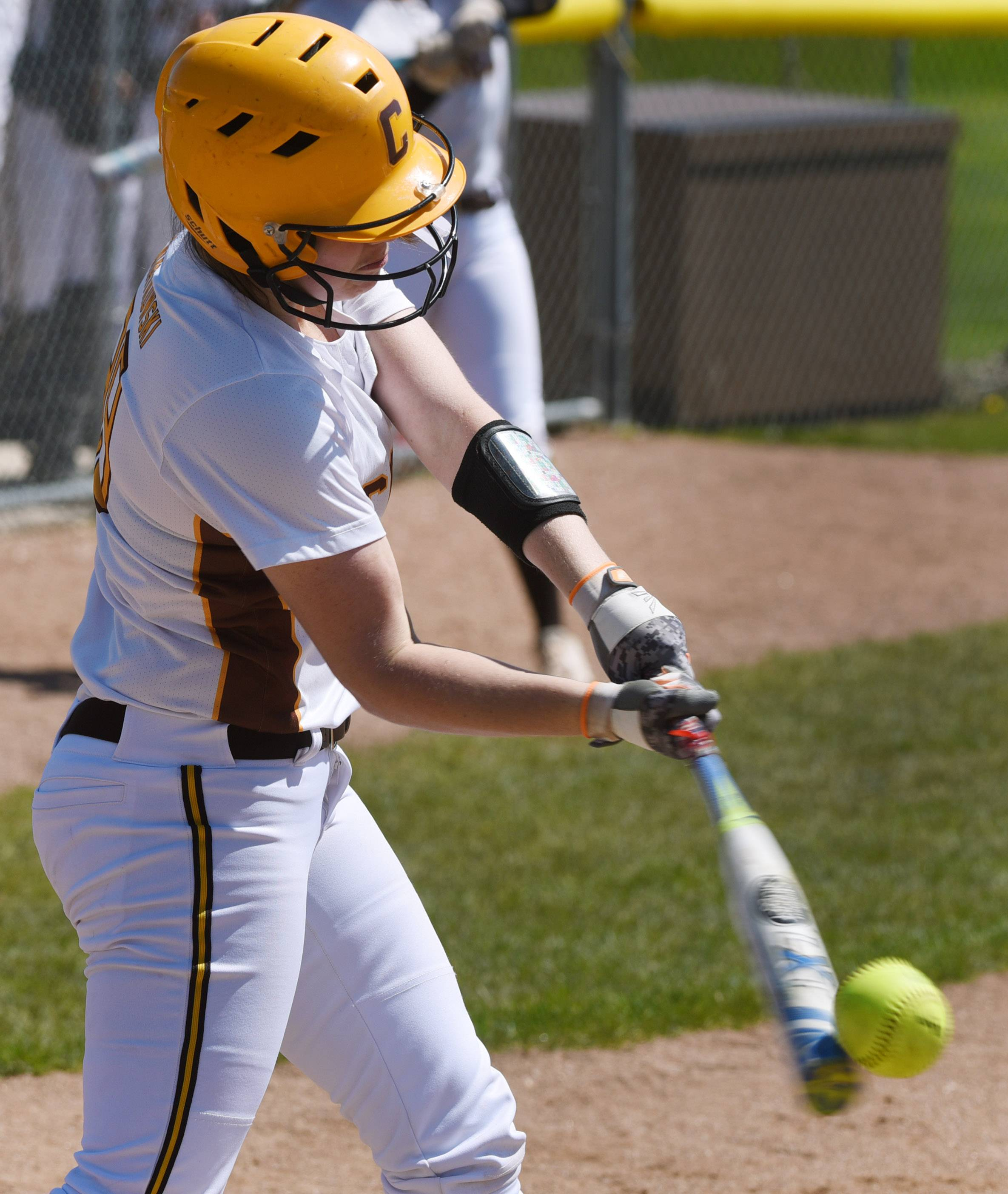 The bat flexes as Carmel's Jordan Swiatkowski fouls off a pitch during the first game of Saturday's doubleheader against Nazareth in Mundelein.