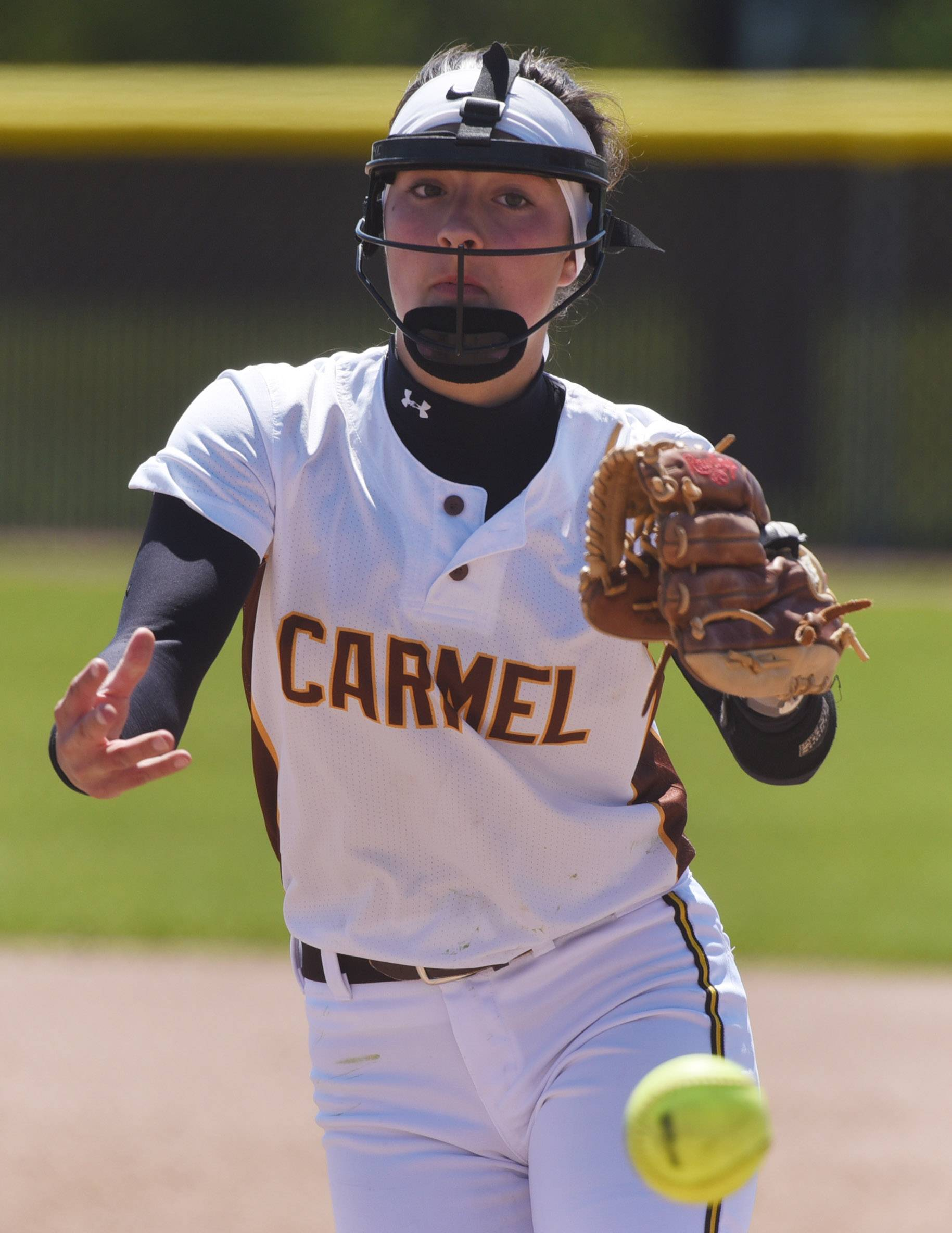 Carmel pitcher Marla Walinski delivers against Nazareth during Saturday's doubleheader in Mundelein.
