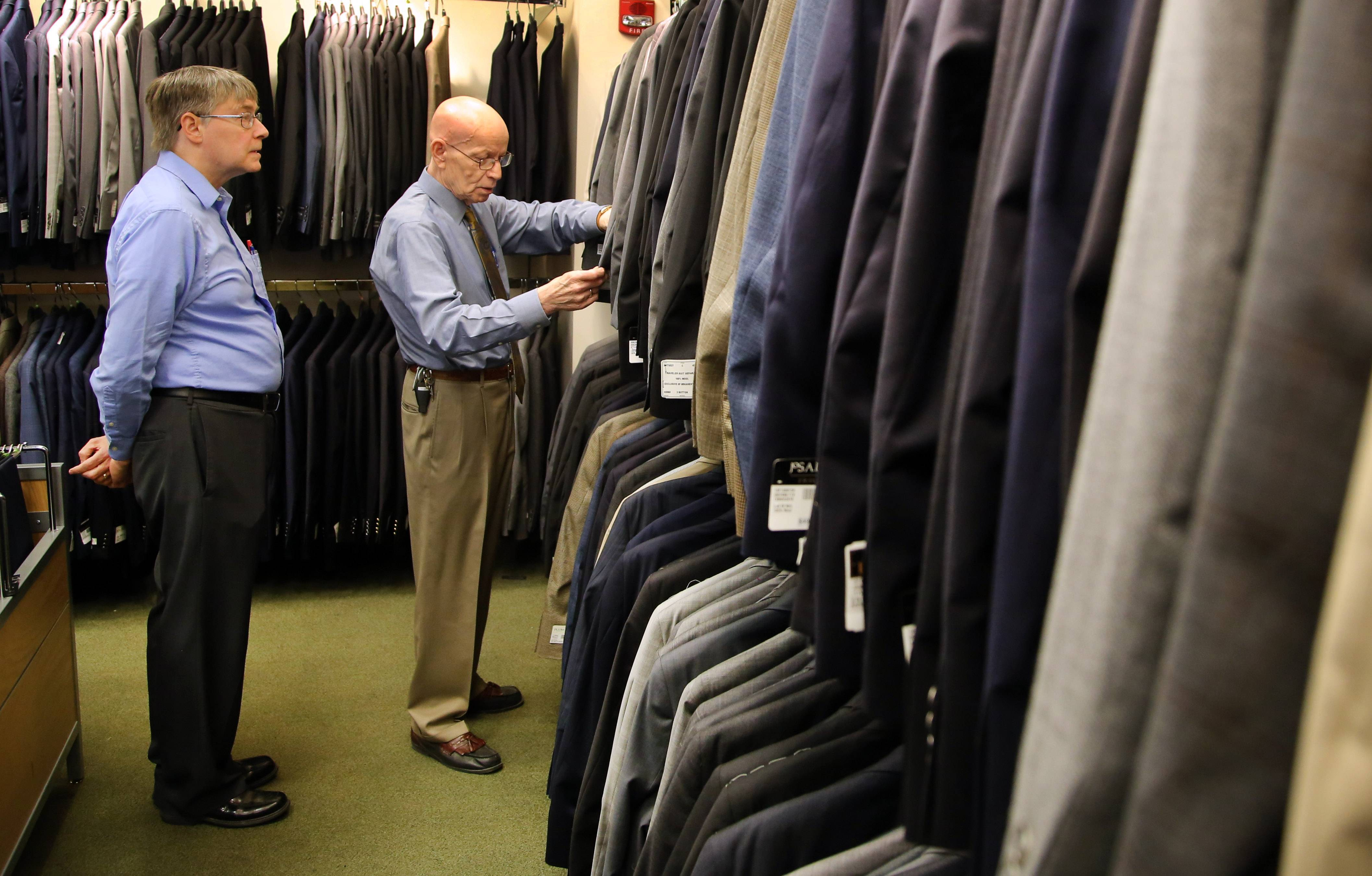 Fittest Loser correspondent Dave Gathman of Elgin, left, looks through suits with sales person Dennis Carnehl at Jos. A. Bank in Deer Park Town Center in preparation for the Fittest Loser finale.