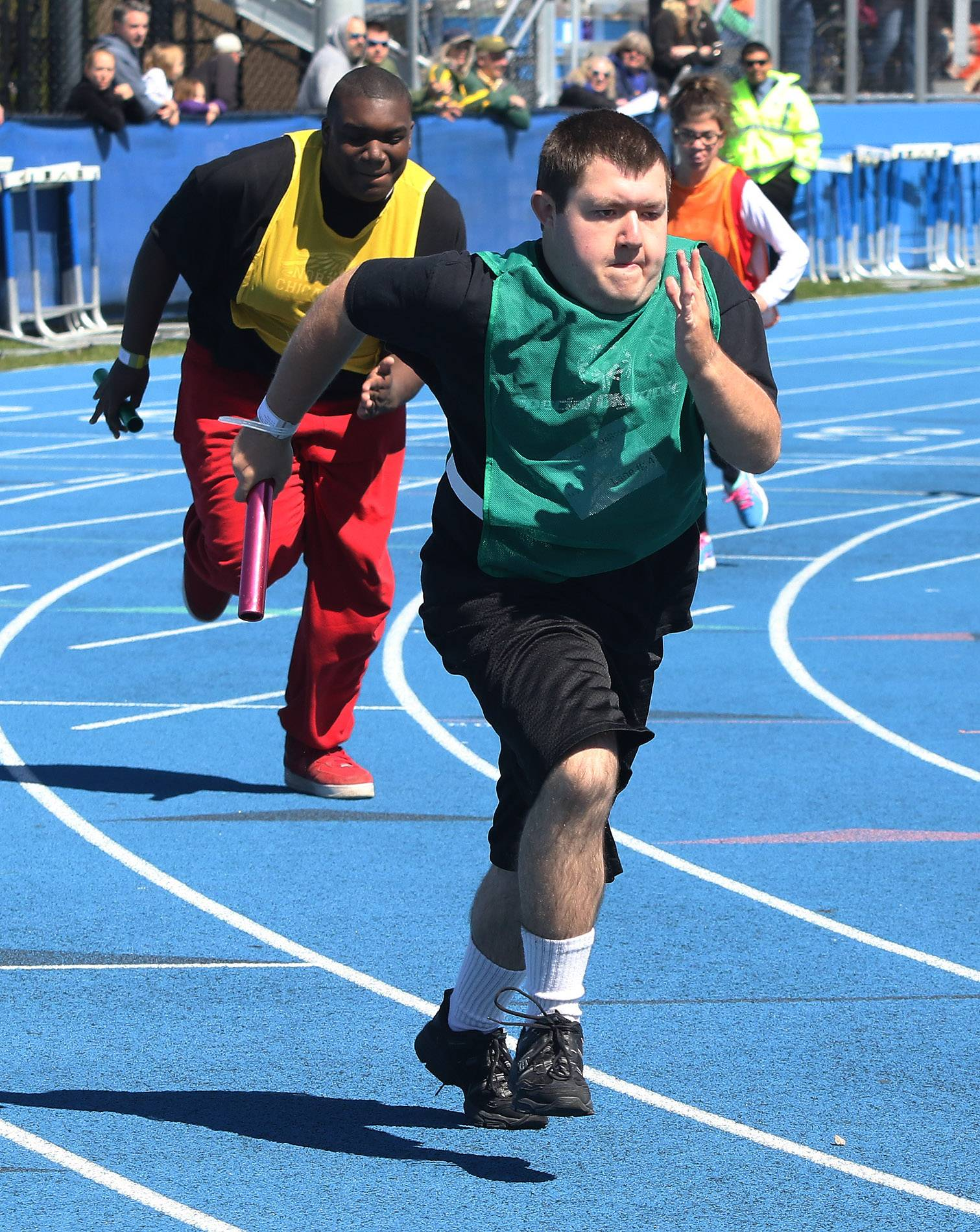Chris Derose of the Vernon Hills High School team starts the 4x100 relay Sunday during Special Olympics Illinois Northeastern/Area 13 Spring Games at Lake Zurich High School.