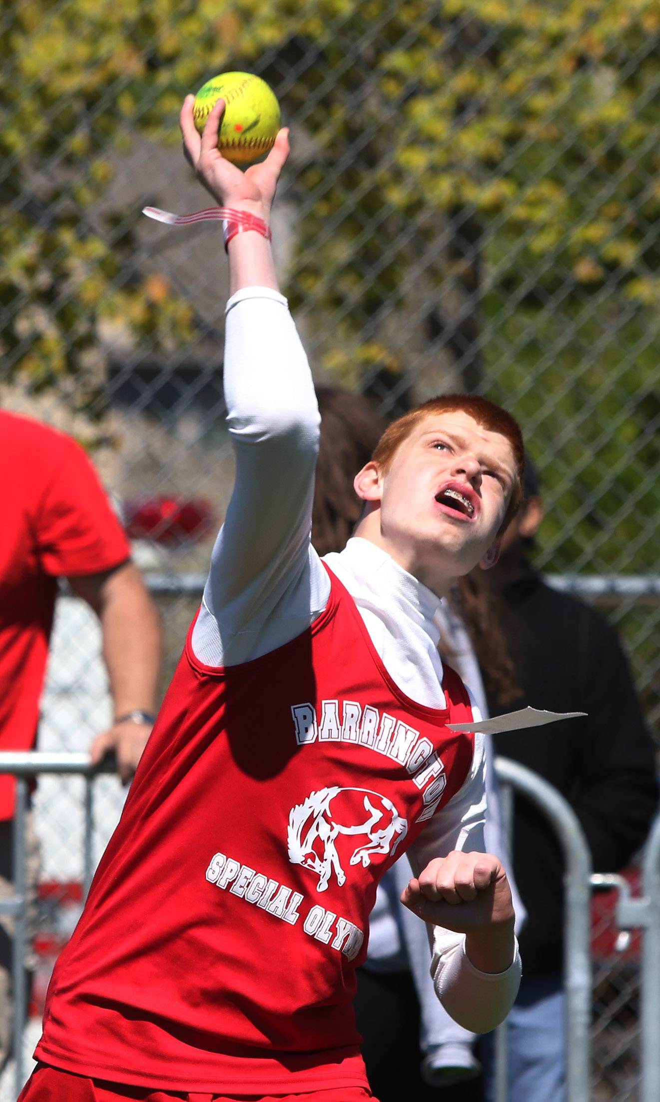 William Karsten of the Barrington High School team throws a softball Sunday during Special Olympics Illinois Northeastern/Area 13 Spring Games at Lake Zurich High School.