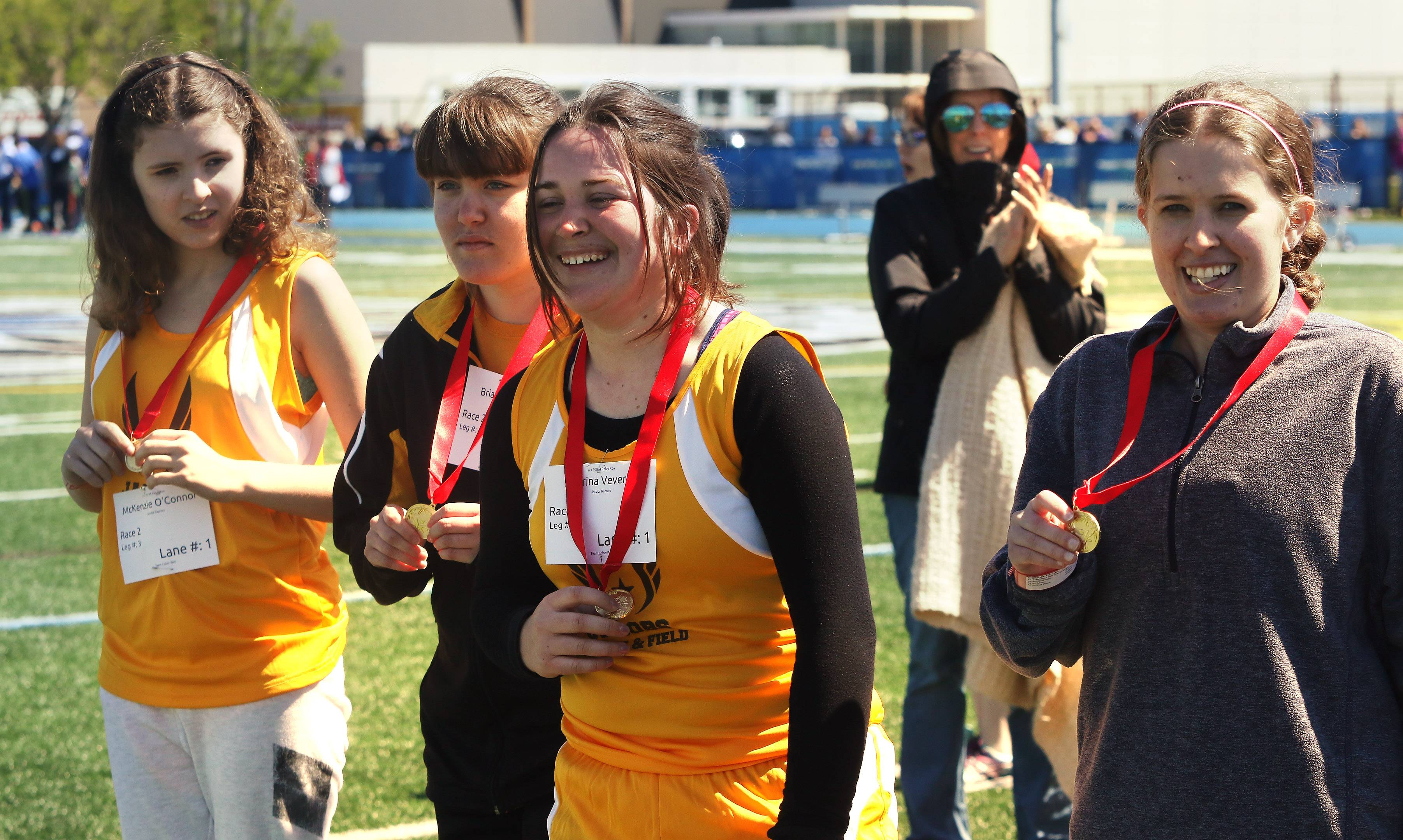 Jacobs High School's McKenzie O'Connor, from left, Briana Edwards, Sabrina Veverka and Hannah O'Connor show off their relay medals Sunday during Special Olympics Illinois Northeastern/Area 13 at Lake Zurich High School.