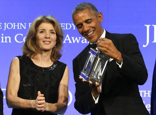 Former President Barack Obama, right, is presented with the 2017 Profile in Courage award by former U.S. Ambassador to Japan Caroline Kennedy, left, during ceremonies at the John F. Kennedy Presidential Library and Museum, Sunday, May 7, 2017, in Boston.