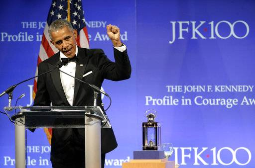 Former President Barack Obama speaks after being presented with the 2017 Profile in Courage award during ceremonies at the John F. Kennedy Presidential Library and Museum Sunday, May 7, 2017, in Boston.