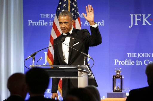 Former President Barack Obama waves at the conclusion of his remarks after being presented with the 2017 Profile in Courage award during ceremonies at the John F. Kennedy Presidential Library and Museum, Sunday, May 7, 2017, in Boston.