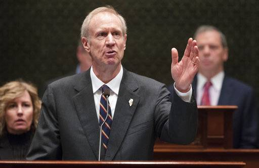 FILE - In this Jan. 25, 2017 file photo, Gov. Bruce Rauner speaks in the Illinois House chamber in Springfield, Ill. In Illinois, a state that expanded coverage under former President Obama's Affordable Care Act, Rauner says he will push senators to change the Republican efforts to overhaul the ACA, so the impacts are not as dire for his state. (Ted Schurter/The State Journal-Register via AP, File)