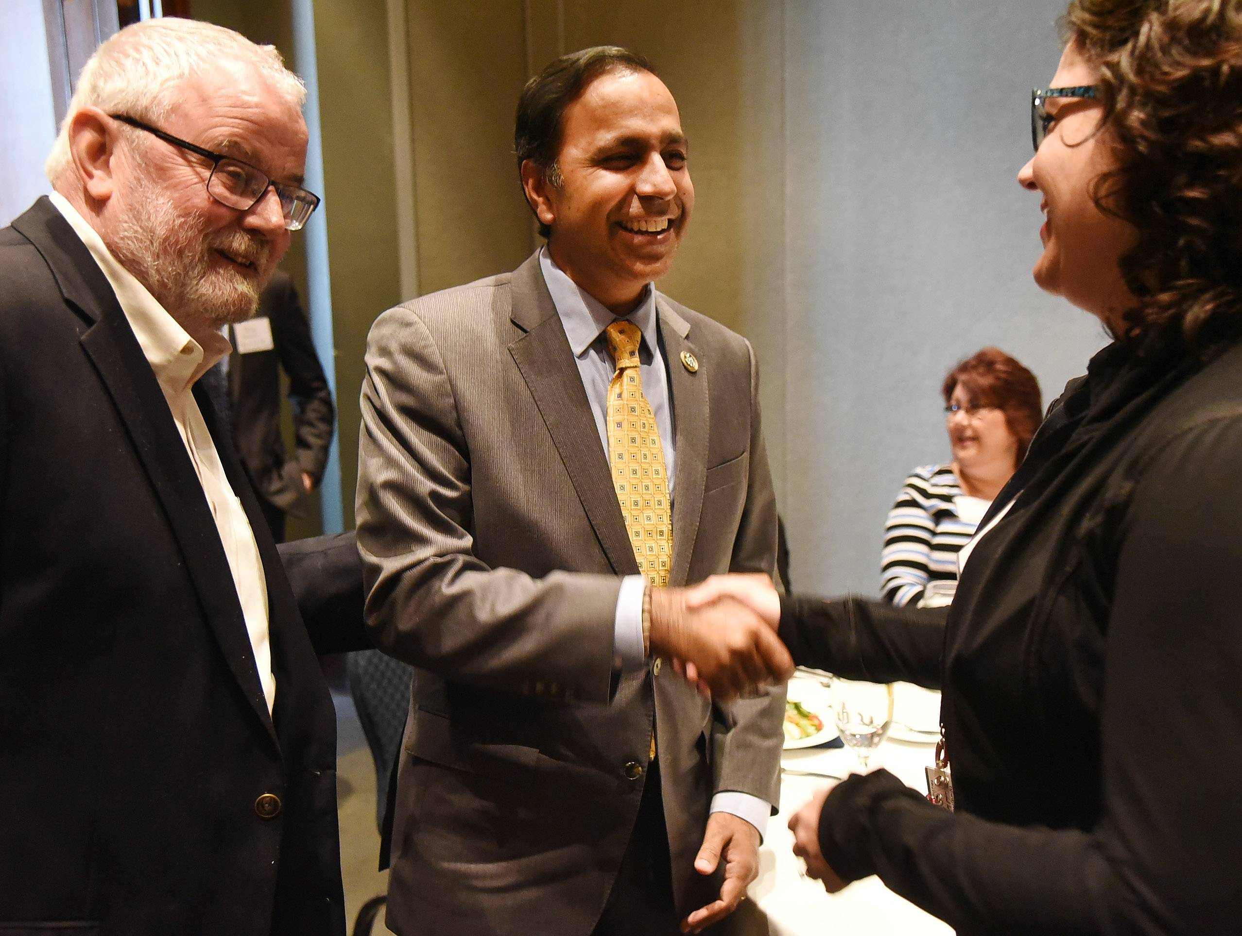 Democratic U.S. Rep. Raja Krishnamoorthi visits with Hoffman Estates Mayor William McLeod and Hoffman Estates Director of Operations and Outreach Jennifer Djordjevic before addressing three chambers of commerce Monday about his first months in Washington. He spoke at Stonegate Conference and Banquet Centre in Hoffman Estates.