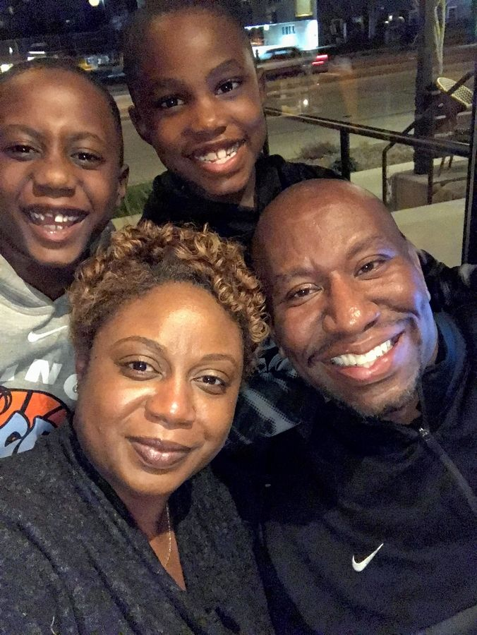 Brian Davis, who owns Hi-Five Sports in Gurnee, lower right, poses with his wife Shantel and his sons Jaxson, at top left, and Carter. Hi-Five offers sports classes to boys and girls from prekindergarten through sixth grade.