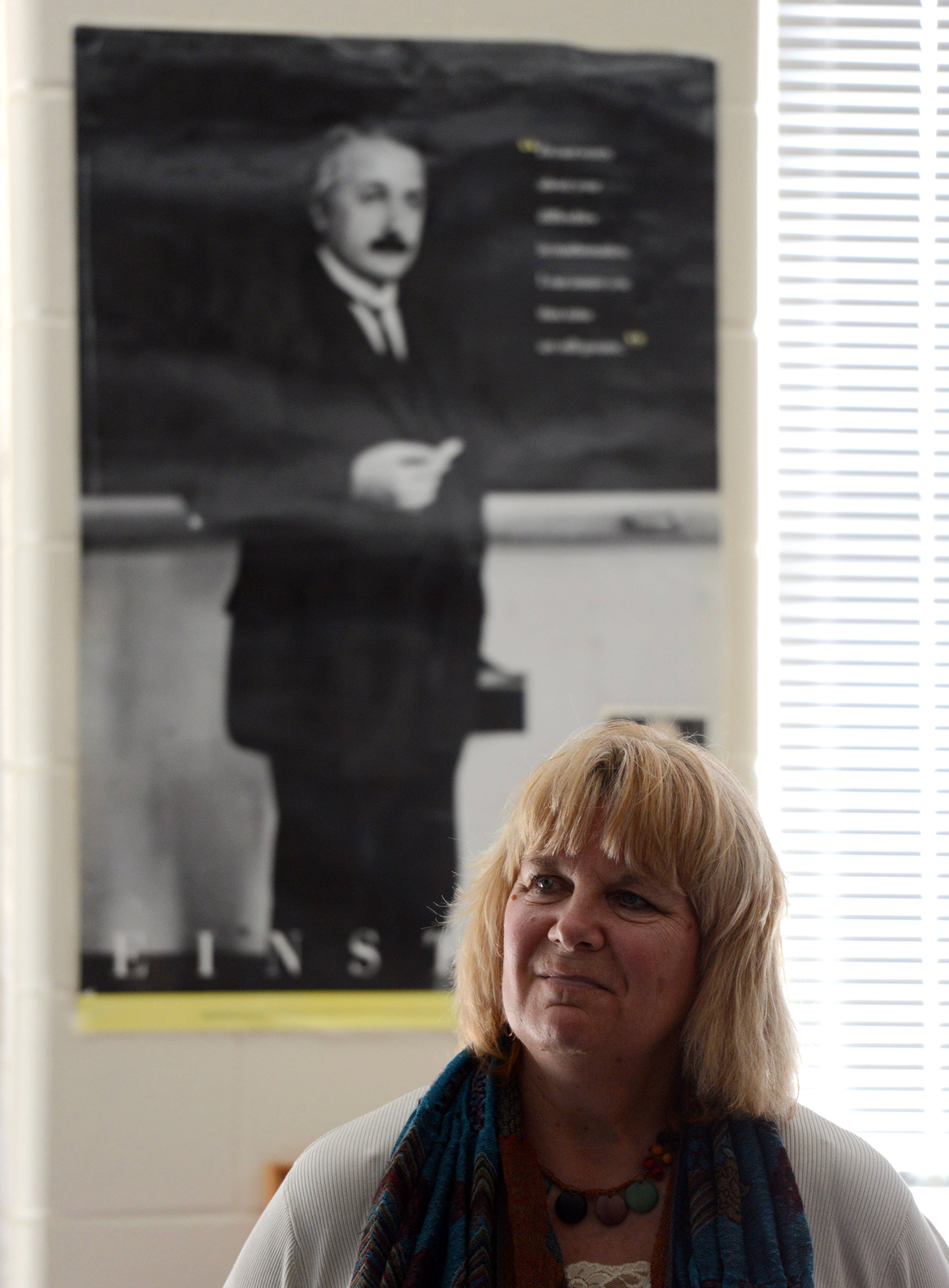 Nancy Krasinski watches as one of her fifth-grade students does a presentation at Williamsburg Elementary School in Geneva. She considers Einstein to be a primary influence on her and her teaching, and representations of him are all over her class in the form of posters, quotes and novelty gifts given by her students.
