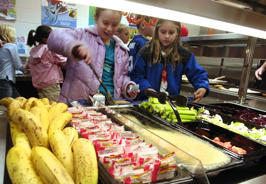 "Third-graders at Spencer Loomis Elementary in Hawthorn Woods select from a ""garden bar."" The Trump administration has relaxed school nutrition guidelines."