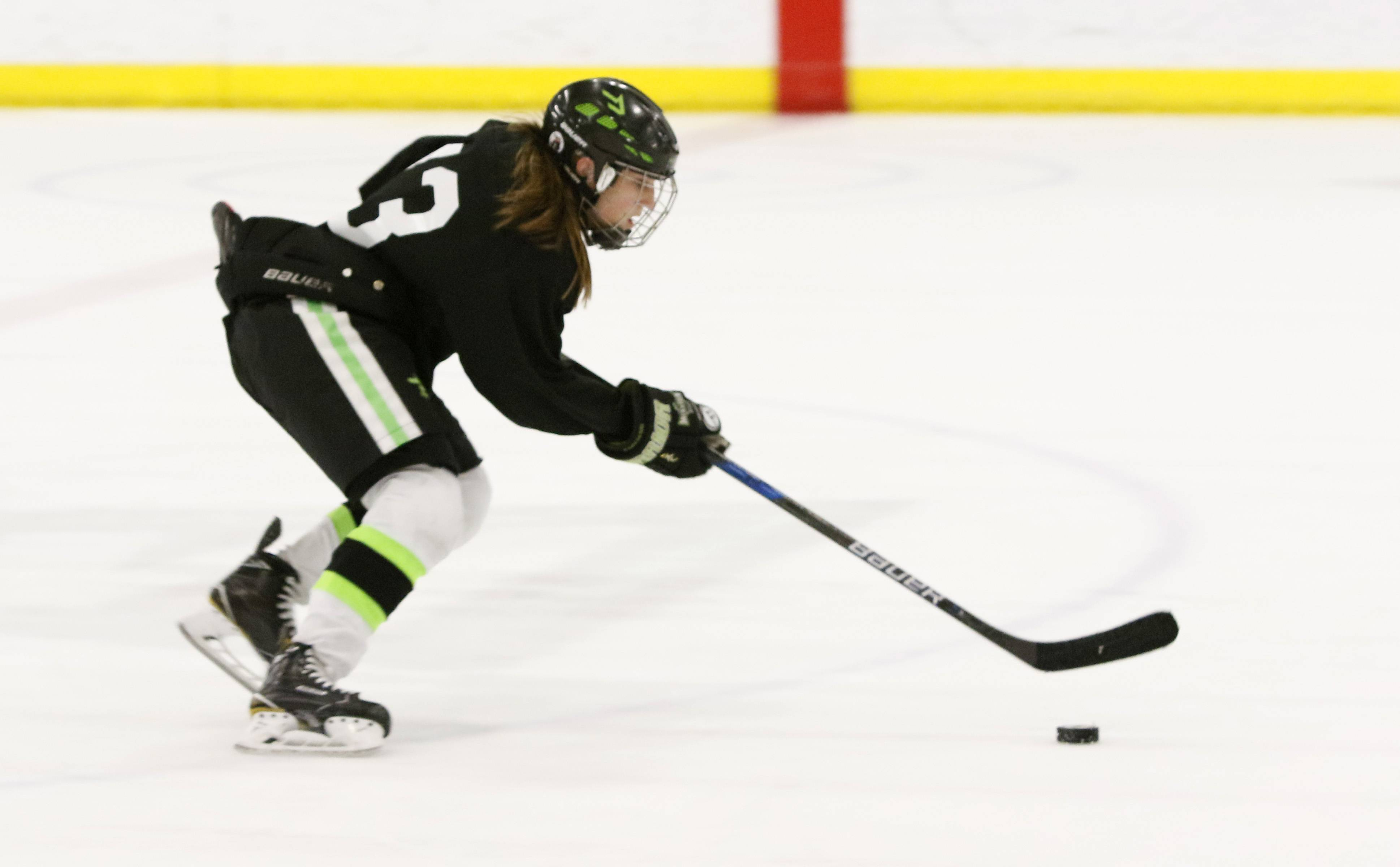 Maddie Gagliano, 13, works on her stick handling skills during practice at Seven Bridges Ice Arena in Woodridge.