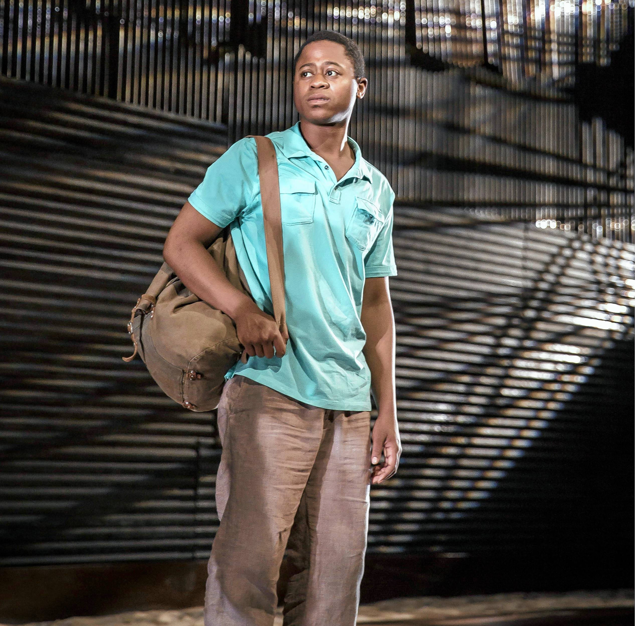 "Daniel Kyri plays Shedrick Kennedy Yarkpai, a Liberian refugee turned actor, in Goodman Theatre's world premiere of Charles Smith's ""Objects in the Mirror."""