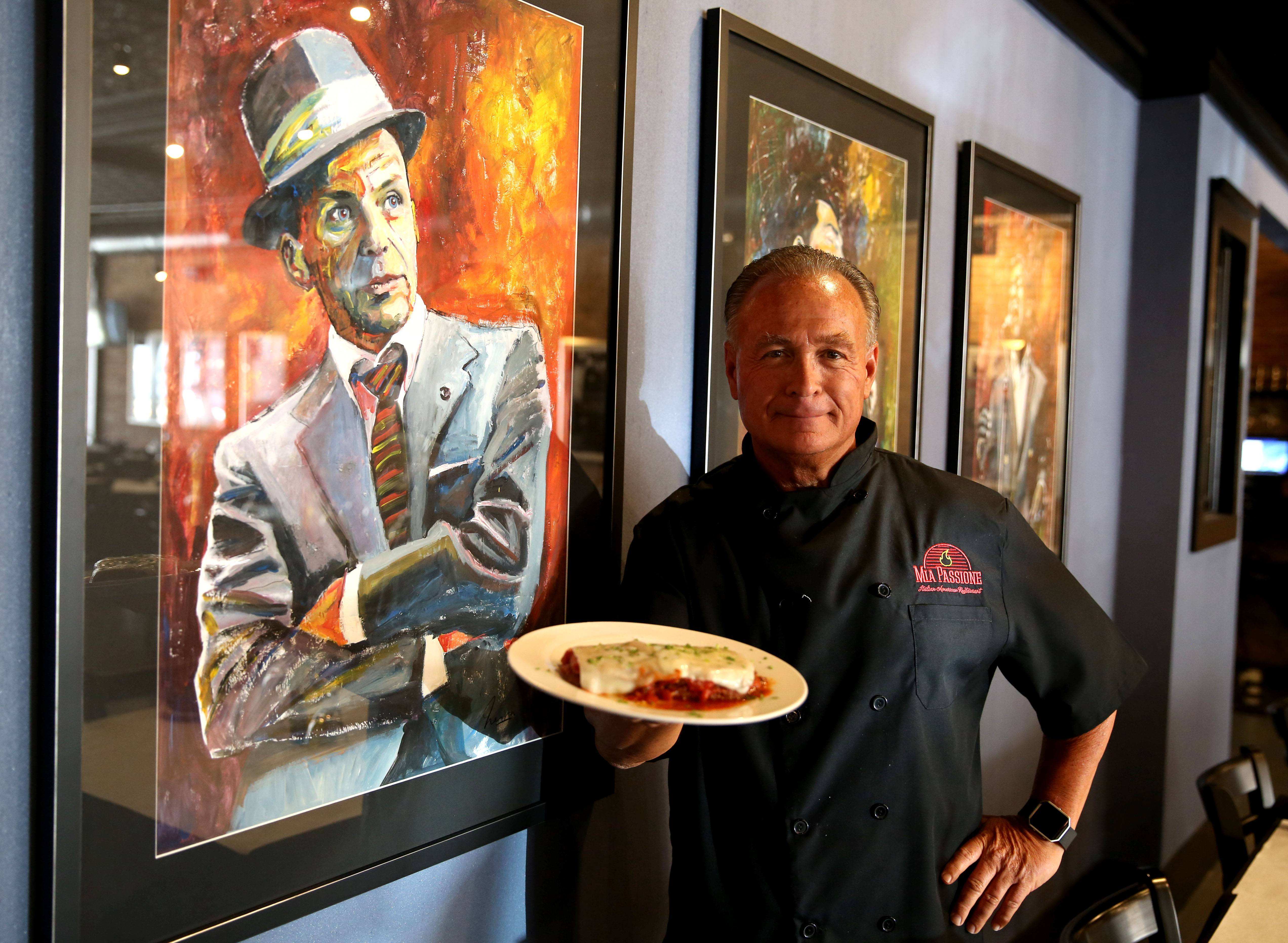 Chef-owner Michael Palmieri, holding a plate of eggplant parmigiana, recently opened a second location of Mia Passione, this time in Woodstock.
