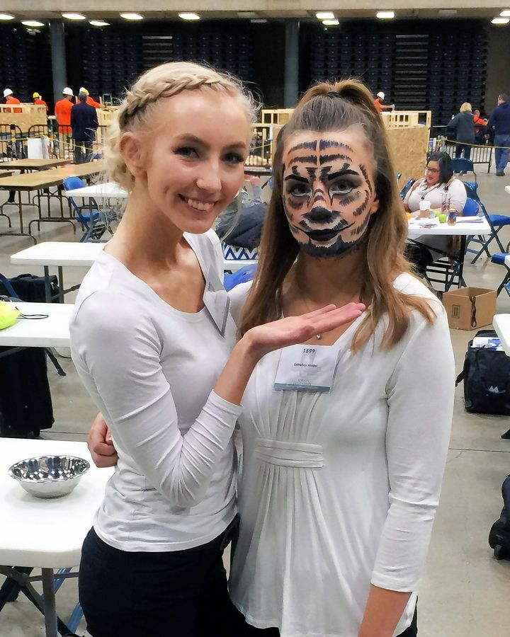 Jamie Shorner, SkillsUSA state winner in the esthetics competition, shows off her completed makeup design on model Maya Rebhan. Fantasy makeup technique was one of the many skill demonstrations in the esthetic division. Shorner and Rebhan are Lisle High School seniors in the cosmetology program at Technology Center of DuPage.