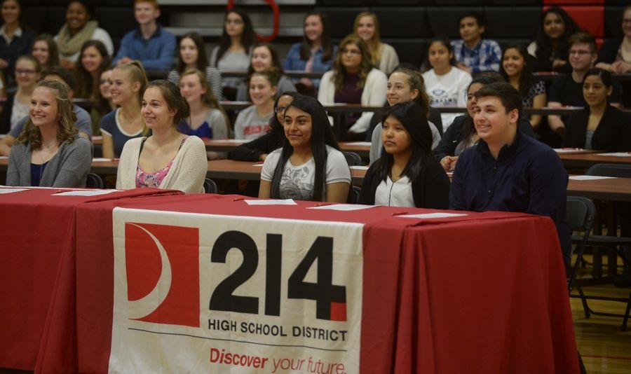 More than 100 Northwest Suburban High School District 214 students pause for photos after signing letters of intent to become teachers as part of Thursday's Educator Prep event at Forest View Education Center in Arlington Heights,