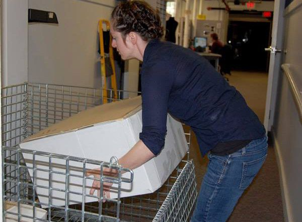 Dunn Museum Registrar Corinne Court prepares carefully-packed items from the collections.