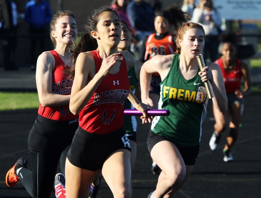 Barrington's Gabby Cossio races against Fremd's Cara Ogilvy to finish the 4x100 relay in the Class 3A girls track sectional Thursday at Grayslake North.