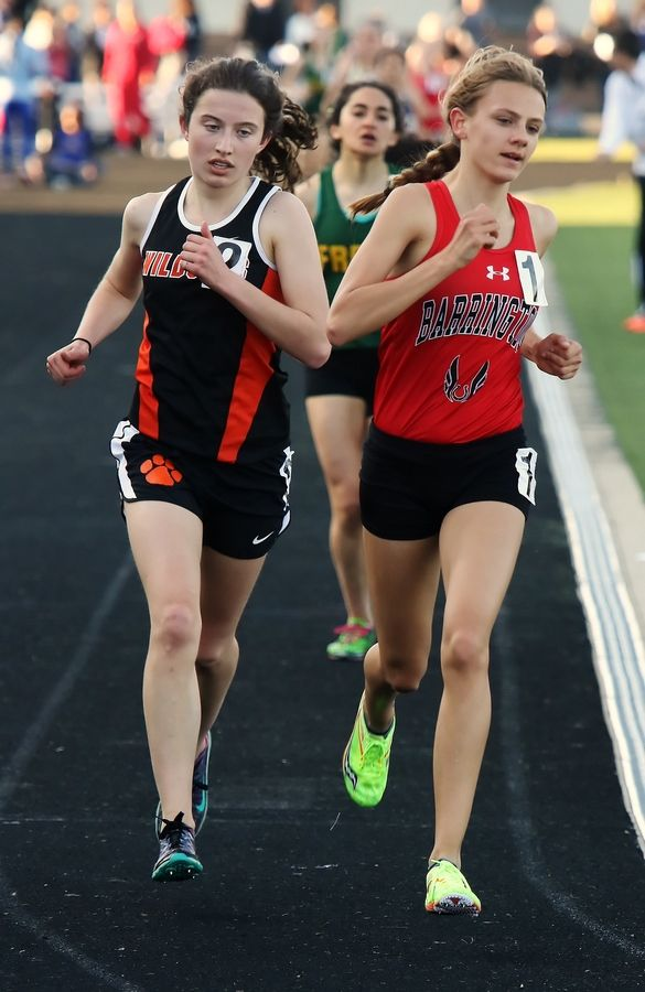 Libertyville runner Melissa Manetsch rides side by side with Barrington runner Jocelyn Long in the 3,200-meter run during the Class 3A girls track sectional Thursday at Grayslake North.