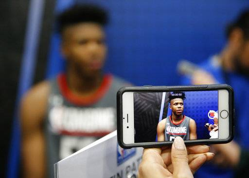 CORRECTS ID TO JUSTIN PATTON, FROM CREIGHTON, NOT CAMERON OLIVER, FROM UTAH - Justin Patton, from Creighton, displayed on a cellular phone video,  responds to a question at the NBA draft basketball combine Thursday, May 11, 2017, in Chicago.