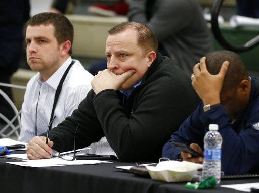 Minnesota Timberwolves coach Tom Thibodeau, center, watches NBA prospects at the basketball league's draft combine Thursday, May 11, 2017, in Chicago.