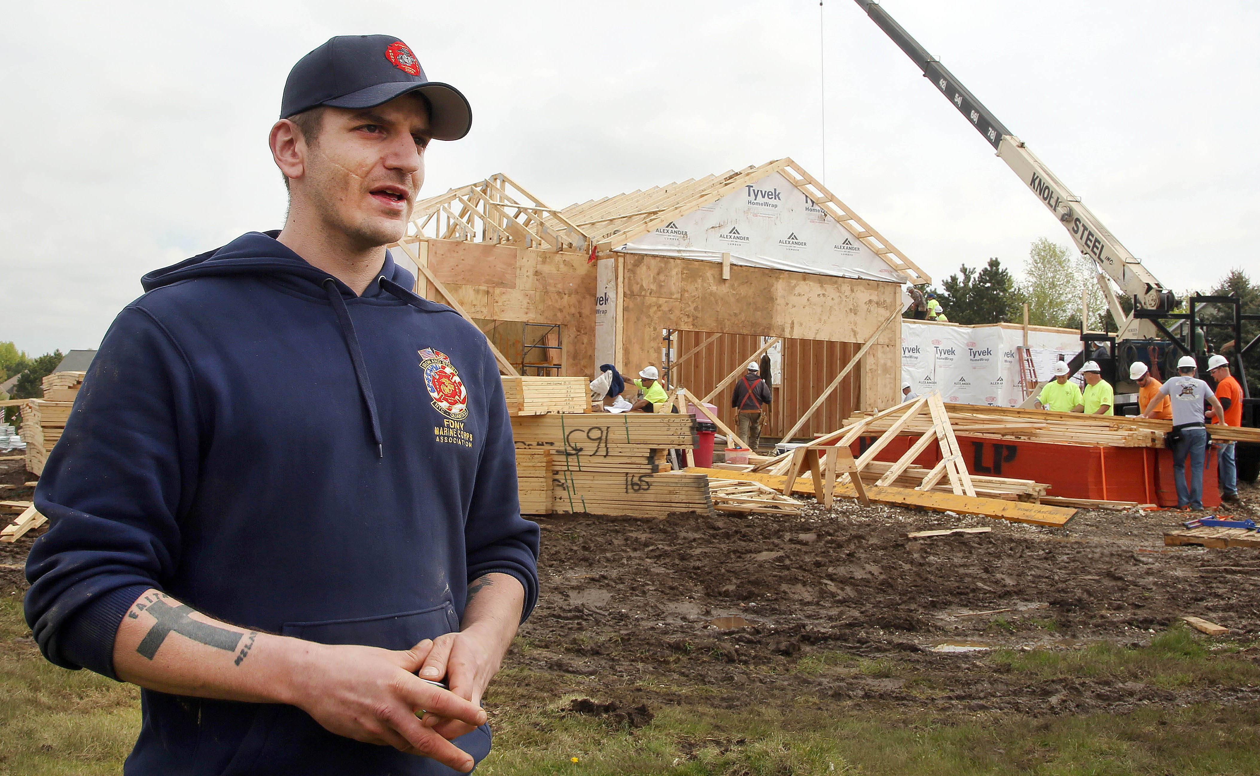 Army veteran Tony Chobanov of Naperville reflects on the generosity of volunteers who began construction on a new home for him and his family Thursday in Spring Grove.
