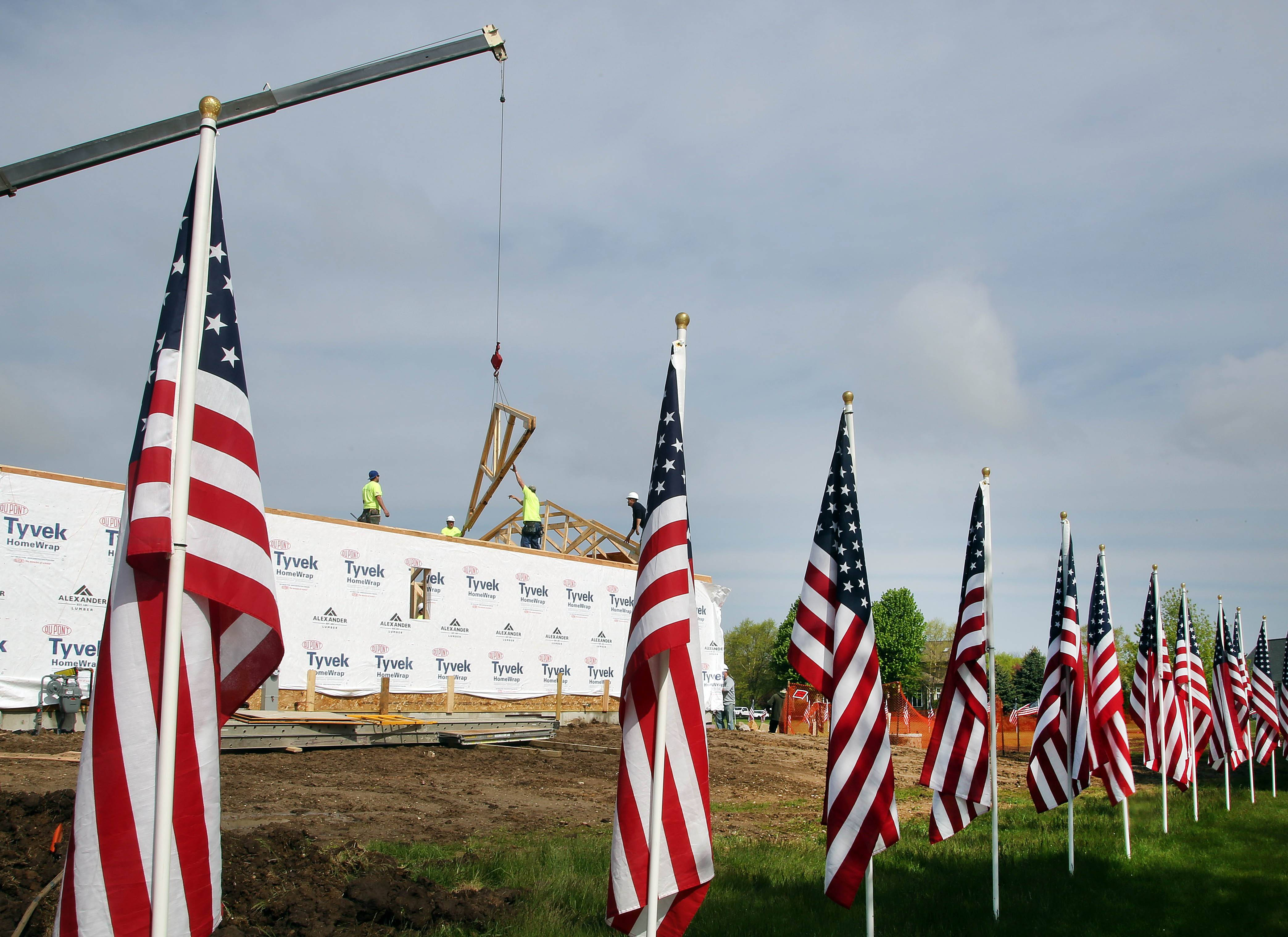 Volunteers began building a house Thursday in Spring Grove for Army veteran Tony Chobanov of Naperville. Chobanov and his family were selected for the house by Arlington Heights nonprofit A Soldier's Journey Home.