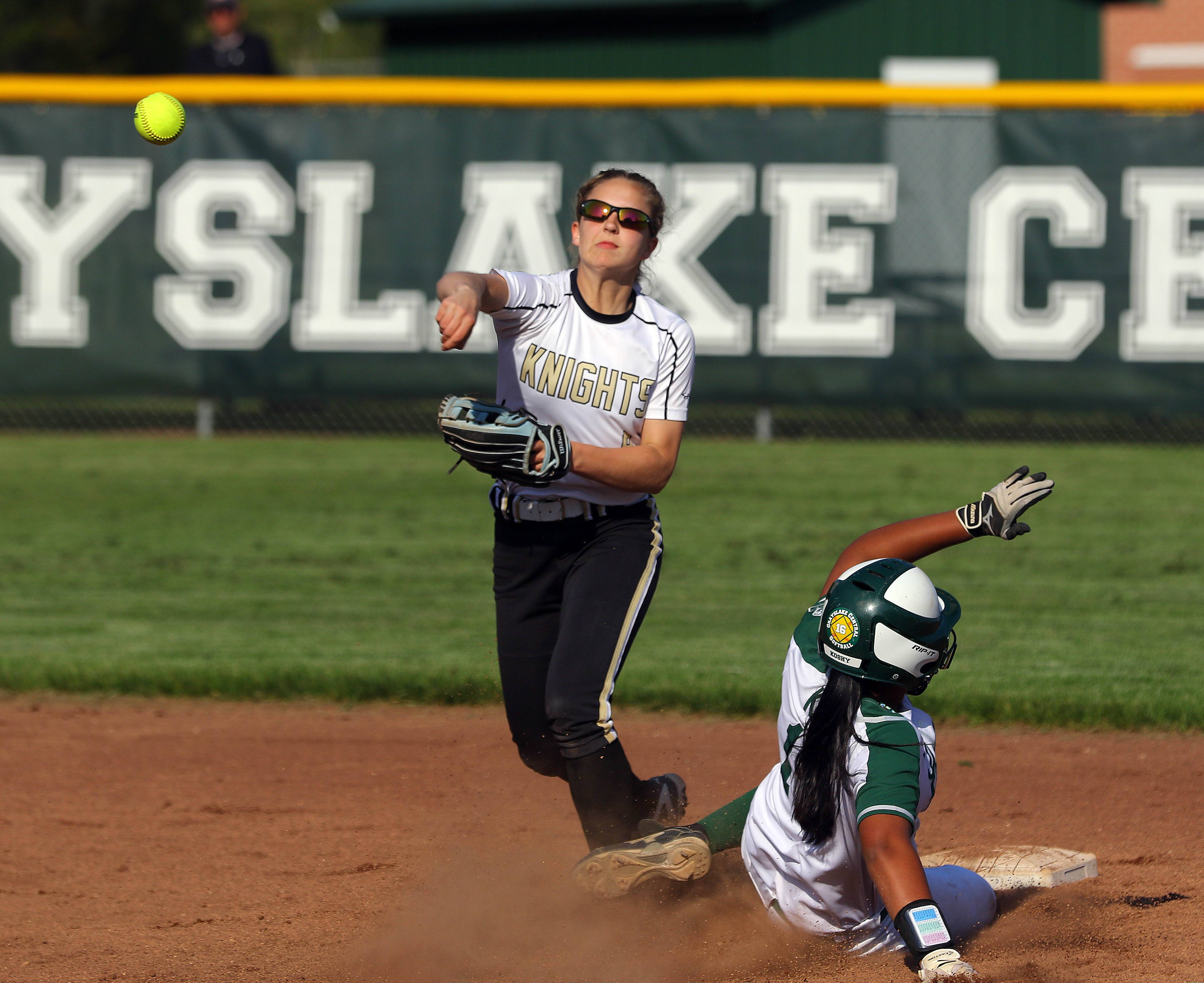 Grayslake Central's Elisa Koshy, right, is out at second as Grayslake North's Faith Standerski throws to first base Friday at Grayslake Central.