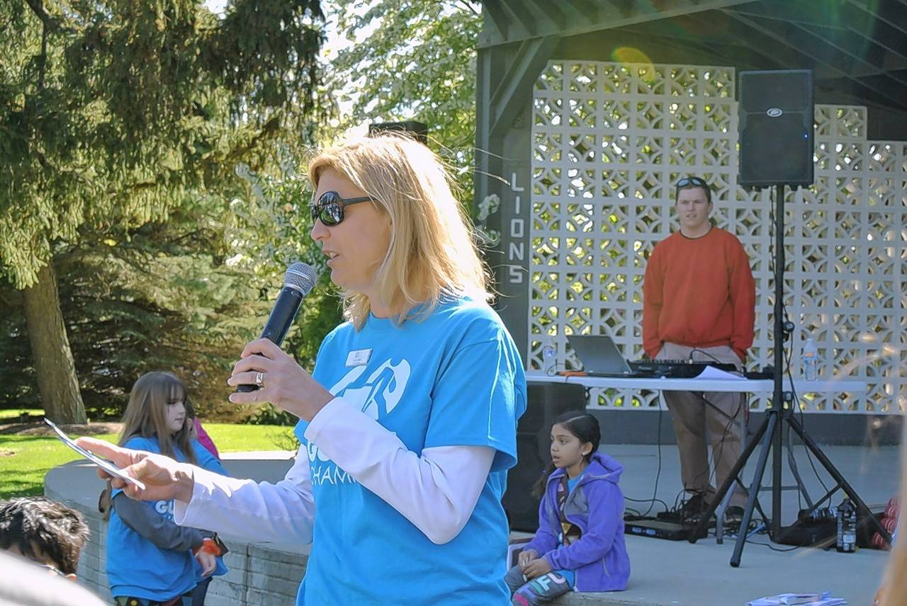 Libby Baker, vice president of the Gurnee Park District Board of Commissioners, speaks in Gurnee's Viking park at an event to celebrate the anniversary of the Go Gurnee health initiative and kick off the program's next season.