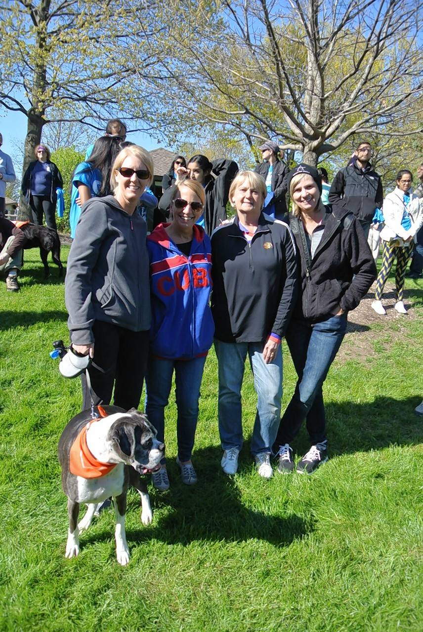 Go Gurnee Champions -- participants in the village's health initiative -- were encouraged to bring dogs to the program's anniversary event to receive Go Gurnee pup bandannas.