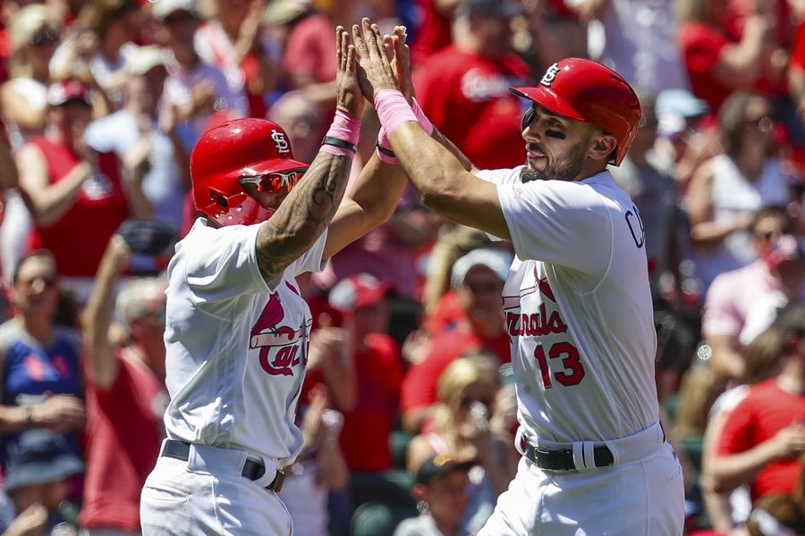 St. Louis Cardinals' Kolten Wong, left, congratulates teammate Matt Carpenter, right, after Carpenter hit a two-run home run off Chicago Cubs' Jake Arrieta during the third inning of a baseball game Sunday, May 14, 2017, in St. Louis.